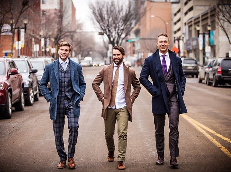 three-men-dressed-in-formal-wear-walking-on-street