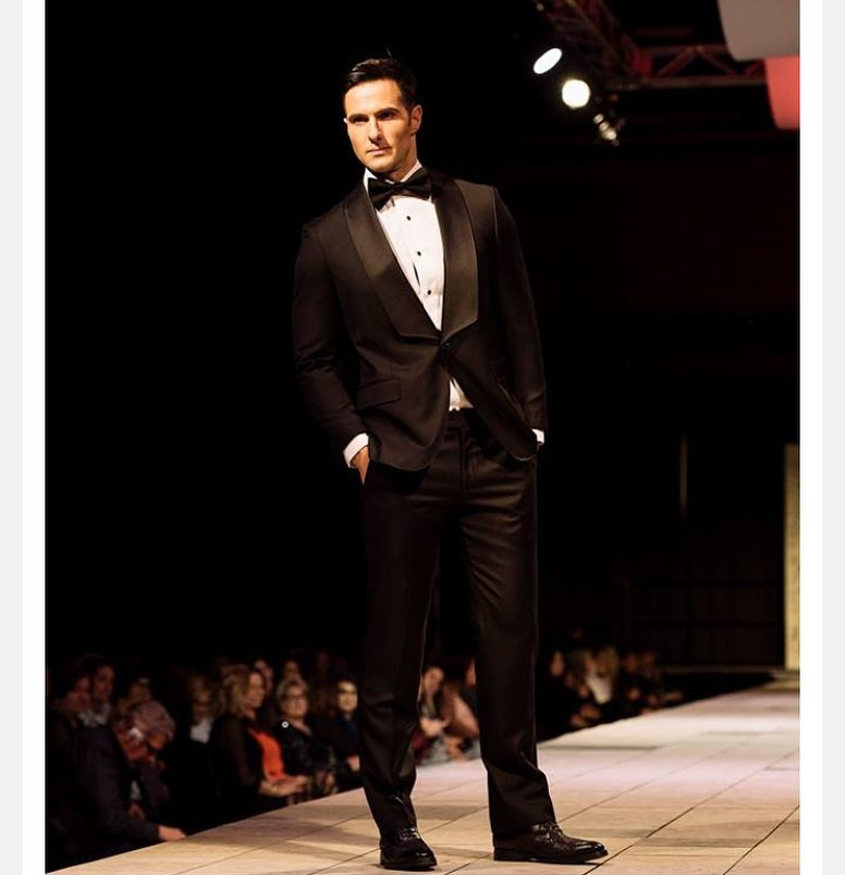man in custom tuxedo on runway