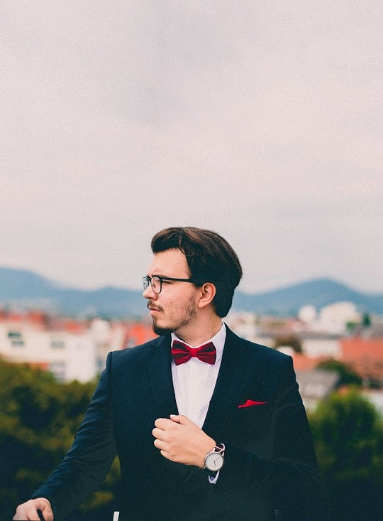 man with red pocket square